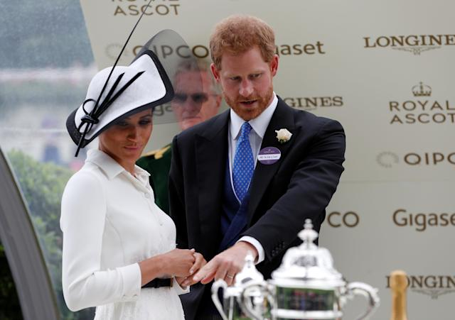 Horse Racing - Royal Ascot - Ascot Racecourse, Ascot, Britain - June 19, 2018 Meghan, the Duchess of Sussex and Britain's Prince Harry look on Action Images via Reuters/Paul Childs