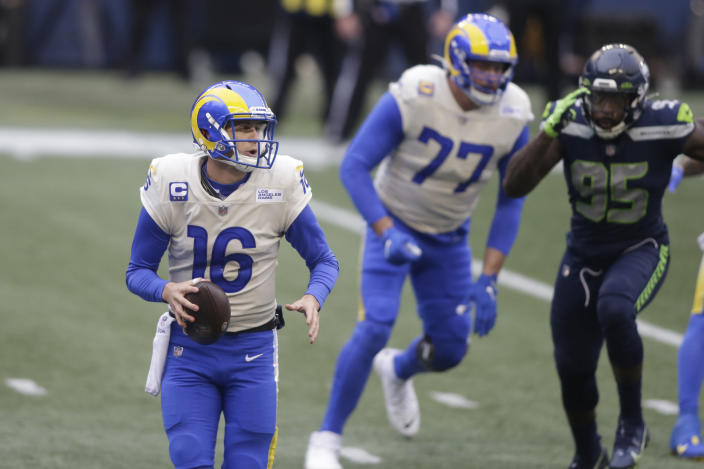 Los Angeles Rams quarterback Jared Goff (16) scrambles as he looks for room to pass against the Seattle Seahawks during the first half of an NFL wild-card playoff football game, Saturday, Jan. 9, 2021, in Seattle. (AP Photo/Scott Eklund)