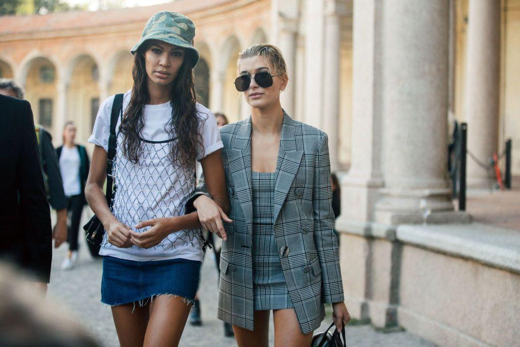 """<p>The <em><a href=""""https://www.crfashionbook.com/celebrity/g22102957/joan-smalls-best-fashion-looks-birthday/"""" target=""""_blank"""">CR </a></em><a href=""""https://www.crfashionbook.com/celebrity/g22102957/joan-smalls-best-fashion-looks-birthday/"""" target=""""_blank"""">girl</a> opted for a camouflage bucket hat to top off her look consisting of a white t-shirt, netted cami, and denim mini skirt.<em></em></p>"""