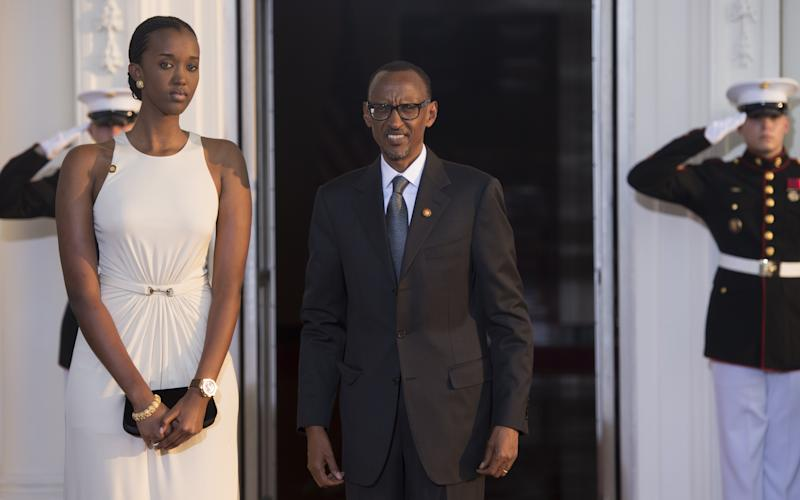Rwanda President Paul Kagame and daughter arrive at the White House for a group dinner during the US Africa Leaders Summit August 5, 2014 in Washington, DC