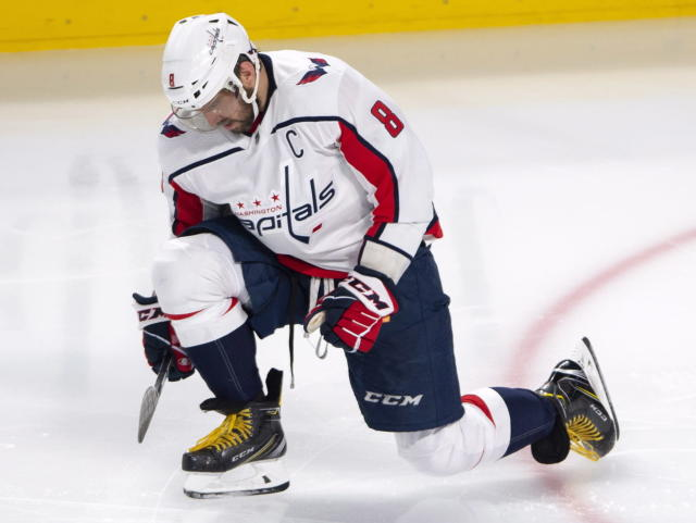 Washington Capitals left wing Alex Ovechkin (8) celebrates after scoring during third period NHL hockey action against the Montreal Canadiens Monday, Nov. 19, 2018 in Montreal. (Ryan Remiorz/The Canadian Press via AP)