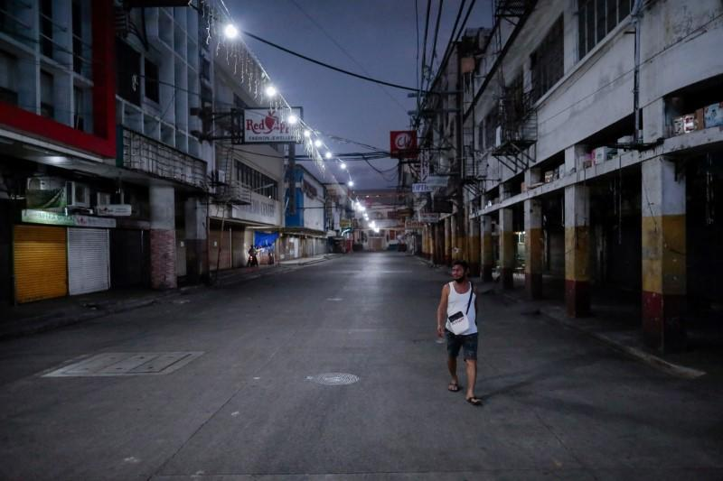 FILE PHOTO: Empty streets are seen as the lockdown continues to contain the coronavirus disease (COVID-19) in Manila