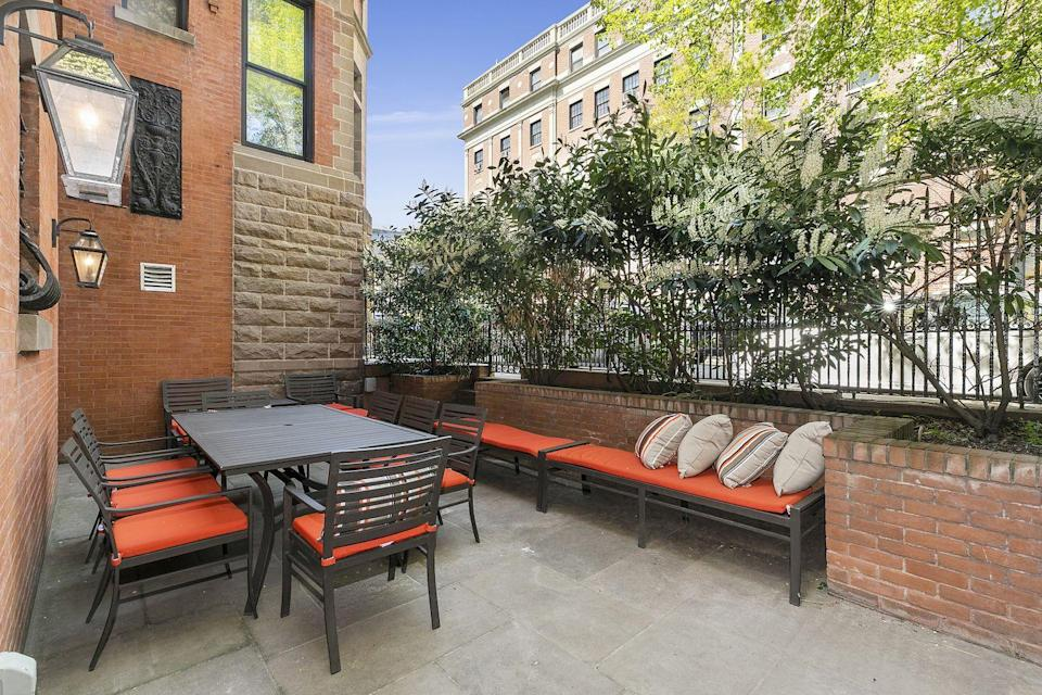 <p>Renters can enjoy a patio (pictured), garden, front yard, and backyard. </p>