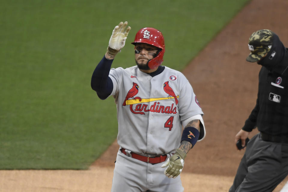 St. Louis Cardinals' Yadier Molina (4) waves after hitting a solo home run during the fourth inning of a baseball game against the San Diego Padres, Saturday, May 15, 2021, in San Diego. (AP Photo/Denis Poroy)