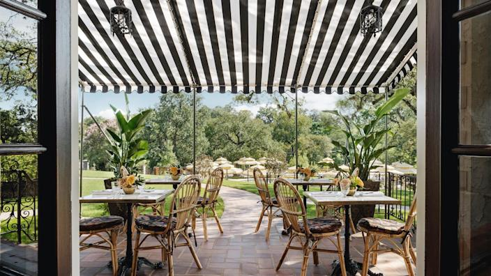 """<p><strong>Why book?</strong> A revitalized, 10,800-square-foot 1928 Italianate mansion and newly-built Inn that block out the hurried city beyond.</p> <p><strong>Set the scene:</strong> Although it's a mere 10 minutes north of Downtown <a href=""""https://www.cntraveler.com/destinations/austin?mbid=synd_yahoo_rss"""" rel=""""nofollow noopener"""" target=""""_blank"""" data-ylk=""""slk:Austin"""" class=""""link rapid-noclick-resp"""">Austin</a> and off busy Red River Street, you'd never know it. Across from the over 120-year-old Hancock Golf Course and with Waller Creek streaming through the 10-acre property, the Commodore Perry Estate feels like a rural European hideaway. The restored 1928 Italianate Mansion and three-story newly-built Inn are enveloped by humungous oak trees, flowing fountains, and pristine, English-style gardens. When you wander the manicured grounds, you'll spot well-heeled adults in flowy patterned dresses and summer linens dining on the Terrace while families skirt around the fountains and splash in the 50-foot oval swimming pool. The Estate feels as if you've removed yourself from bustle-y Hyde Park in Central Austin and can take a relaxed, meditative breath.</p> <p><strong>The backstory:</strong> Formerly the country home of Commodore Edgar Perry and Lutie Perry and the setting for their wild Roaring Twenties parties, they sold the estate in 1944 because, as Edgar said, the Mansion was """"a great place to throw a party, but too big to live in."""" The Estate then became St. Mary's Academy and several other schools until California-based Auberge Resorts Collection scooped it up and fashioned it into its next life as the brand's first city-based hotel. Auberge, well-known for its generously sized, luxury retreats, was particular about every detail, including utilizing original elements like the spiral staircase, terra-cotta tiles in the Solarium, and the antique light fixtures that help you feel the history. Now it's an escape-like property a short jaunt from the city that feel"""