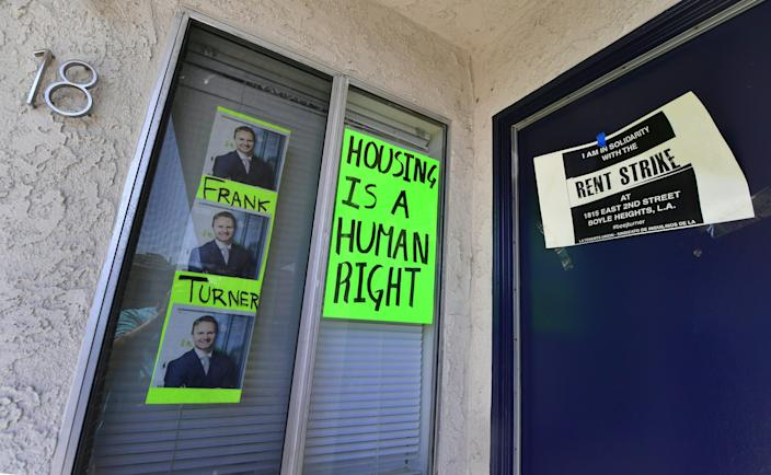 Signs and posters are seen on an apartment block where, with no rent control due to the year it was built, the landlord has increased some rents by as much as $800 in Boyle Heights, Los Angeles. (Photo: Frederic J. Brown/AFP/Getty Images)