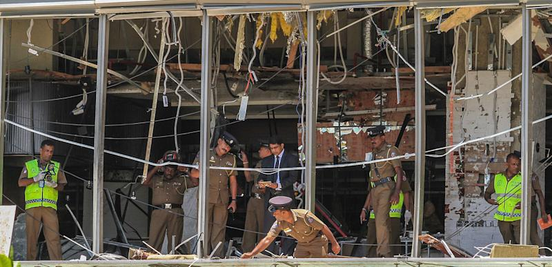 A Sri Lankan Police officer inspects a blast spot at the Shangri-la hotel in Colombo, Sri Lanka, Sunday, April 21, 2019. More than hundred were killed and hundreds more hospitalized with injuries from eight blasts that rocked churches and hotels in and just outside of Sri Lanka's capital on Easter Sunday, officials said, the worst violence to hit the South Asian country since its civil war ended a decade ago. (AP Photo/Chamila Karunarathne)
