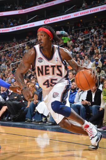 NEWARK, NJ - APRIL 23: Gerald Wallace #45 of the New Jersey Nets drives against the Philadelphia 76ers on April 23, 2012 at the Prudential Center in Newark, New Jersey. (Photo by Jesse D. Garrabrant/NBAE via Getty Images)