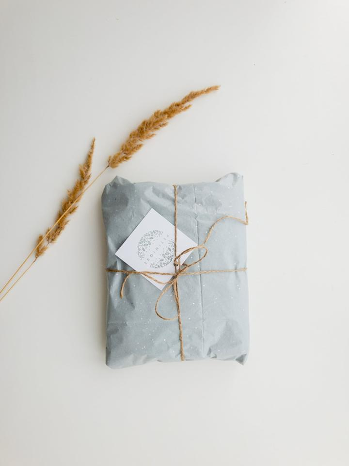 <p>Instead of wrapping presents in paper wrapping paper that's sure to be thrown away after being opened, try wrapping gifts in reusable fabric and tying it nicely with a string. Your gifts will look stunning and you won't be wasting as much!</p>
