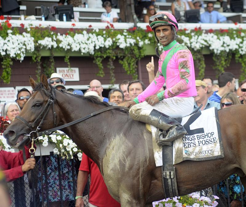 Rajiv Maragh with Caleb's Posse in the winner's circle after The King's Bishop Stakes at Saratoga in 2011. (AP)