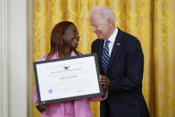 """President Joe Biden recognizes Sandra Lindsay as an """"Outstanding American by Choice,"""" a U.S. Citizenship and Immigration Services program that recognizes citizens who have been naturalized in the East Room of the White House, Friday, July 2, 2021, in Washington. Lindsay is believed to be the first American to be vaccinated against COVID-19 outside of a clinical trial. She works as director of nursing for critical care at Northwell Health's Long Island Jewish Medical Center in Queens, New York. (AP Photo/Patrick Semansky)"""
