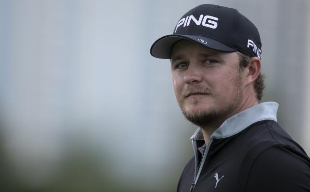 England's Eddie Pepperell reacts on the 17th hole during the second round of the Dubai Desert Classic golf tournament in Dubai, United Arab Emirates, Friday, Jan. 24, 2020. (AP Photo/Kamran Jebreili)
