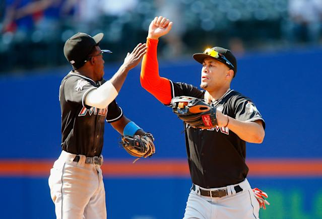 The Marlins have already traded Dee Gordon (left). Will Giancarlo Stanton be next? (Getty)