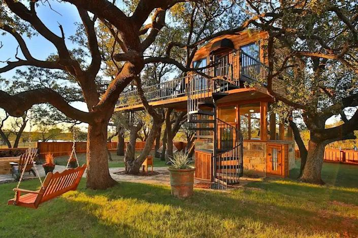 """<p><strong>Baird, Texas</strong></p> <p>If you're looking for a vacation rental in the Lone Star state, consider a trip to Baird, where the Ryders Treehouse instantly captivates with an outdoor spiral staircase that leads up to a plush bedroom and well-stocked screened kitchen. The outdoor offerings are just as cozy in this two-story treehouse: Relax on the hammock or on the porch swing that hangs from the sturdy branch of one of the many live oak trees that surround the property.</p> $295, Airbnb. <a href=""""https://www.airbnb.com/rooms/30982822"""" rel=""""nofollow noopener"""" target=""""_blank"""" data-ylk=""""slk:Get it now!"""" class=""""link rapid-noclick-resp"""">Get it now!</a>"""