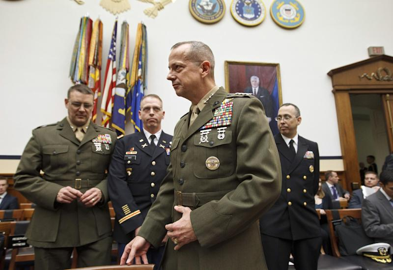 Marine Gen. John Allen, the top U.S. commander in Afghanistan, arrives on Capitol Hill in Washington, Tuesday, March 20, 2012, to testify before the House Armed Services Committee hearing on Afghanistan. (AP Photo/J. Scott Applewhite)