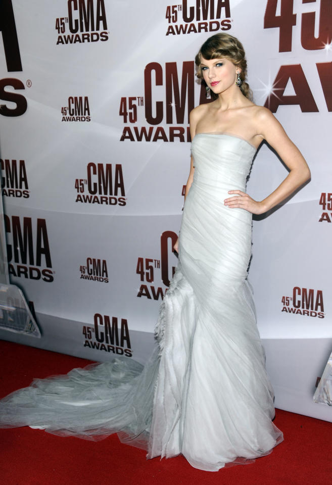 Taylor Swift arrives at the 45th Annual CMA Awards in Nashville on Wednesday, Nov. 9, 2011. (AP Photo/Evan Agostini)