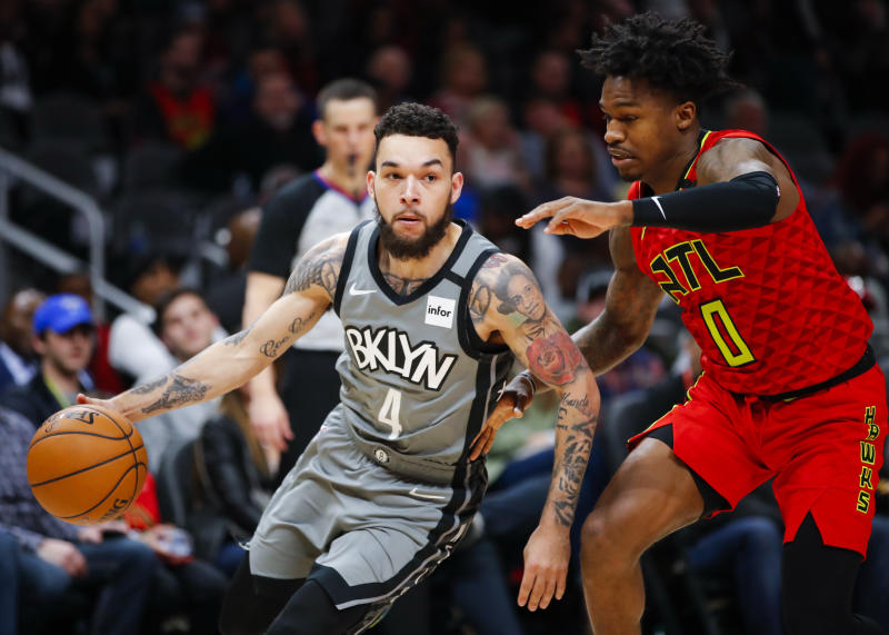 Brooklyn's Chris Chiozza drives to the basket against the Hawks' Brandon Goodwin on Feb. 28 in Atlanta. (Photo by Todd Kirkland/Getty Images)