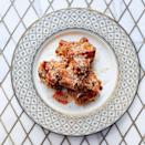 """Oh, look, the two prettiest words in the English language: <em>pickle brine</em>. That's the key to preparing this super-moist, super-crunchy skinless boneless chicken thigh recipe, which you'll finish with a drizzle of honey, a sprinkling of sea salt and sesame seeds, and hot sauce served on the side. <a href=""""https://www.epicurious.com/recipes/food/views/pickle-brined-fried-chicken-51247610?mbid=synd_yahoo_rss"""" rel=""""nofollow noopener"""" target=""""_blank"""" data-ylk=""""slk:See recipe."""" class=""""link rapid-noclick-resp"""">See recipe.</a>"""