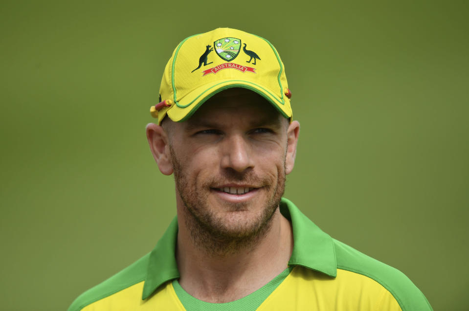 Australia's captain Aaron Finch smiles before the toss ahead of the second Twenty20 cricket match between England and Australia, at the Ageas Bowl in Southampton, England, Sunday, Sept. 6, 2020. (Dan Mullan/Pool via AP)