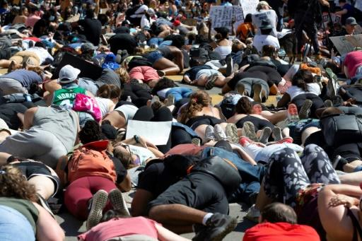 Hundreds of demonstrators lie on the pavement during a rally north of Lafayette Square near the White House to protest police brutality and racism on June 7, 2020