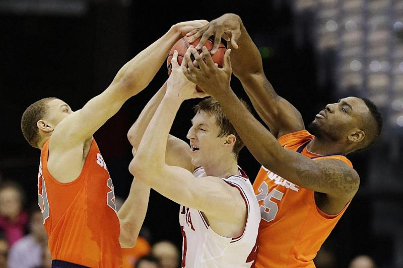 Indiana forward Cody Zeller (40) is trapped between Syracuse guard Brandon Trich, left, and forward Rakeem Christmas (25) during the first half of an East Regional semifinal in the NCAA college basketball tournament, Thursday, March 28, 2013, in Washington. (AP Photo/Alex Brandon)