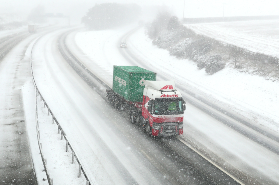 <em>A lorry makes its way along a desolate M9 near Falkirk during a snow blizzard (PA)</em>