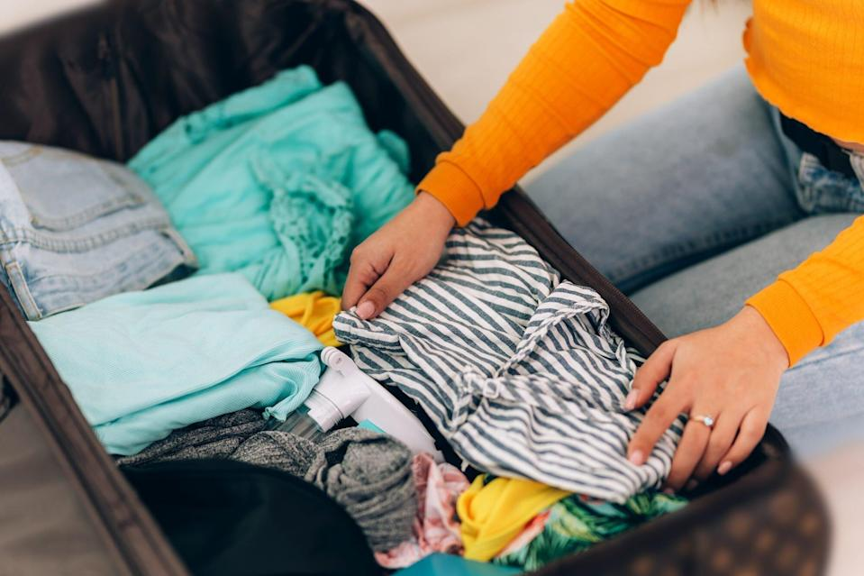 An image of a girl packing.