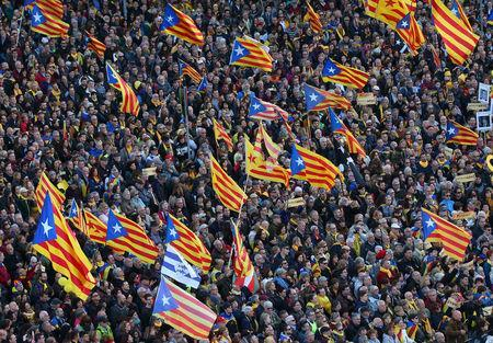 """People fly """"Esteladas"""" (Catalan separatist flag) during a demonstration held by pro-independence associations in Barcelona, Spain March 11, 2018. REUTERS/Albert Gea/Files"""
