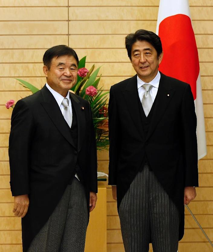 Japanese Prime Minister Shinzo Abe (R) and Olympics Minister Toshiaki Endo have come under fire over a costly stadium planned for the 2020 Games (AFP Photo/Issei Kato)