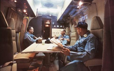 Armstrong (right), Aldrin and Collins inside the quarantine vehicle – where they stayed for 21 days - Credit: GETTY IMAGES
