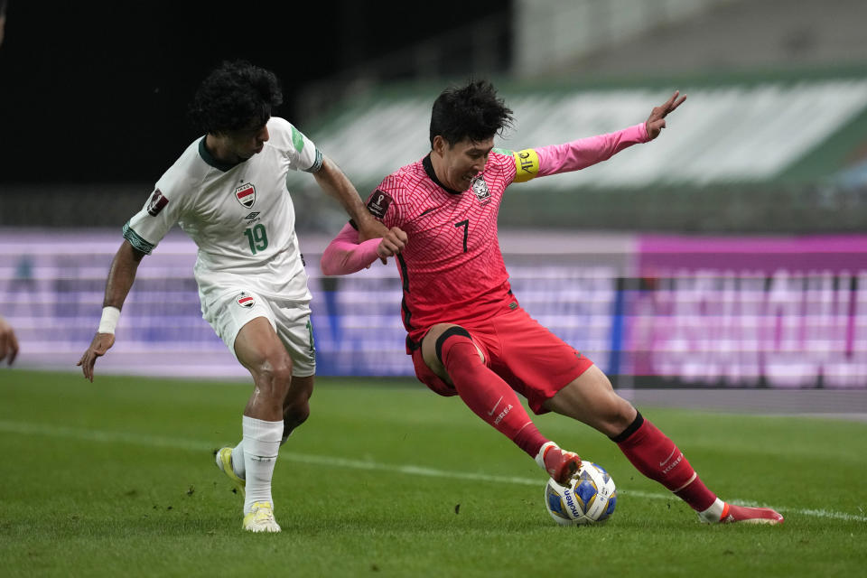 South Korea's Son Heung-min, right, vies for the ball against Iraq's Mohammed Qasim Majid during the final round of their Asian zone group A qualifying soccer match for the FIFA World Cup Qatar 2022 at Seoul World Cup stadium in Seoul, South Korea, Thursday, Sept. 2, 2021. (AP Photo/Lee Jin-man)