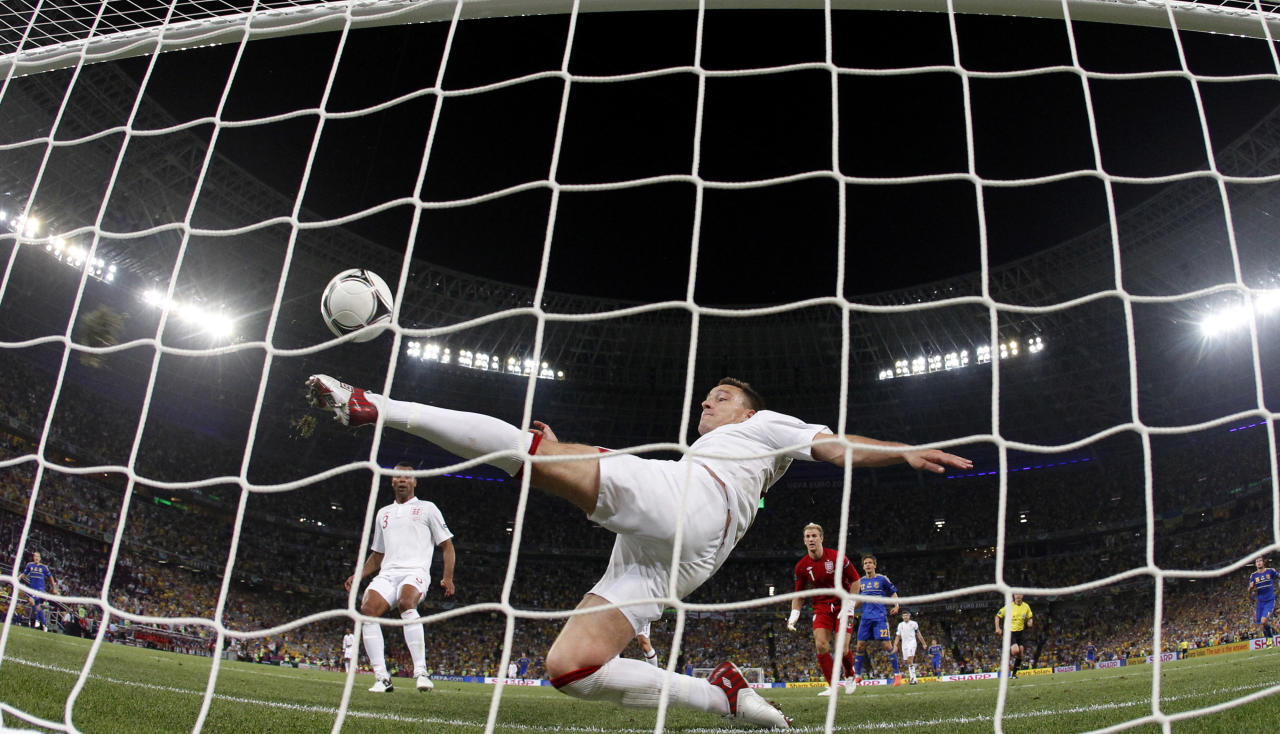 England's John Terry clears the ball away from his goal during the Euro 2012 soccer championship Group D match between England and Ukraine in Donetsk, Ukraine, Tuesday, June 19, 2012. (AP Photo/Matthias Schrader)