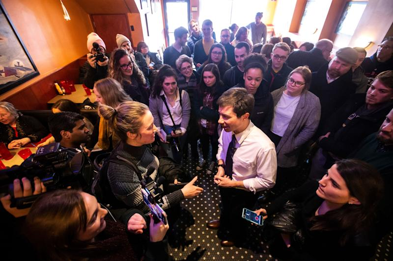 Pete Buttigieg, Mayor of South Bend, Ind. and 2020 Democratic presidential candidate, talks with Daily Iowan reporter Sarah Watson during an event on Monday, March 4, 2019, at The Airliner in downtown Iowa City, Iowa.