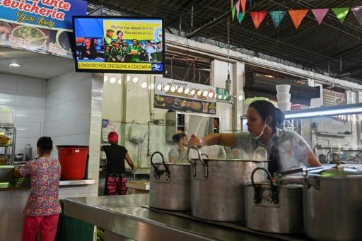 A TV in a market in Cali, Colombia, broadcasts a video posted on YouTube on August 29, 2019 of former senior commander Ivan Marquez and fellow rebel Jesus Santrich announcing that they are taking up arms again