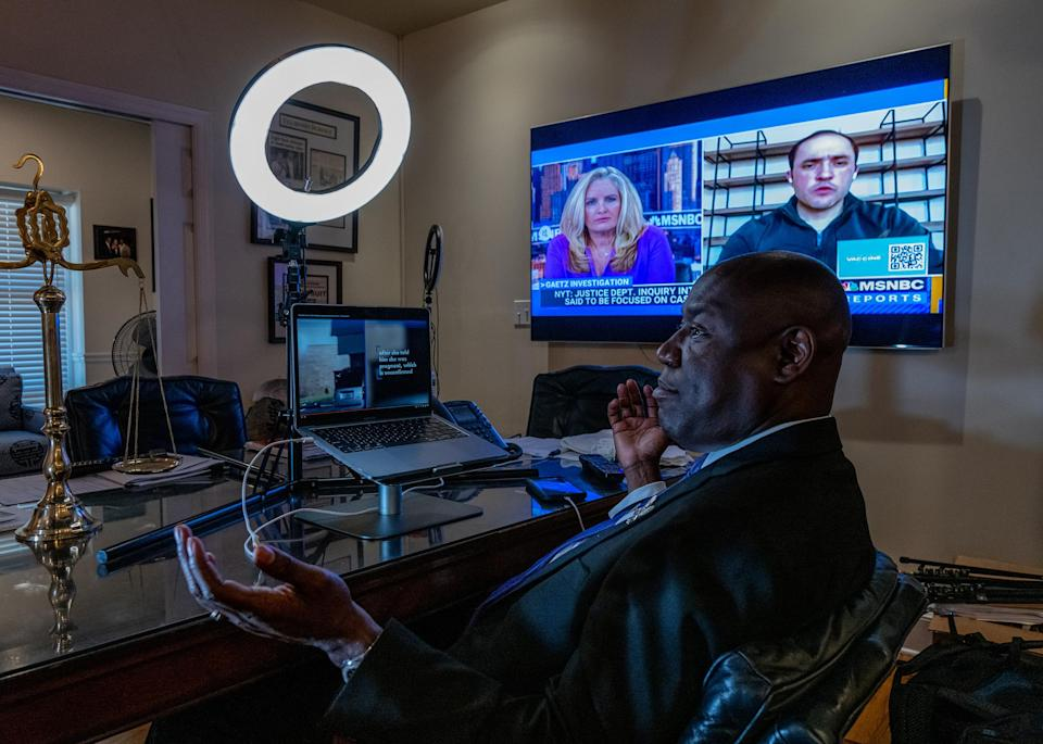 """Crump speaks to co-counsel while watching a video of a shooting in his Tallahassee office on April 3.<span class=""""copyright"""">Ruddy Roye for TIME</span>"""