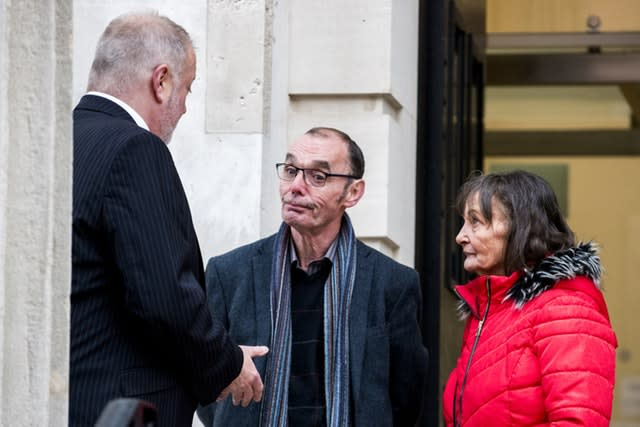 Liam Wray, centre, with his sister Margaret Wray speaking with their solicitor Kevin Casey before the hearing