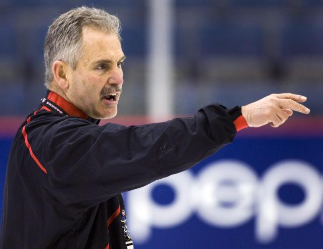 In this Dec. 14, 2009, photo, Canadian national junior team coach Willie Desjardins gives instructions during practice in Regina, Saskatchewan. The Vancouver Canucks hired Desjardins as coach on Monday, June 23, 2014. (AP Photo/The Canadian Press, Ryan Remiorz)