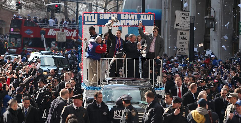 NEW YORK, NY - FEBRUARY 07:  (L-R) Justin Tuck #91 of the New York Giants, New York Gov. Andrew Cuomo, New York City Mayor Michael Bloomberg and quarterback Eli Manning #10 of the New York Giants stand on a float during the Giants' Victory Parade on February 7, 2012 in New York City. The Giants defeated the New England Patriots 21-17 in Super Bowl XLVI.  (Photo by Andrew Burton/Getty Images)