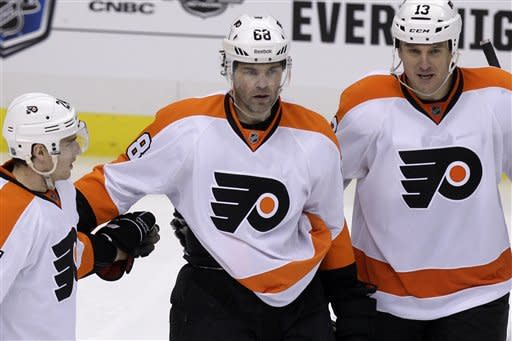 Philadelphia Flyers' Jaromir Jagr (68) celebrates with teammates Matt Read, left, and Pavel Kubina (13) after scoring in the third period during Game 2 of an opening-round NHL hockey playoff series against the Pittsburgh Penguins in Pittsburgh, Friday, April 13, 2012. The Flyers won 8-5. (AP Photo/Gene J. Puskar)