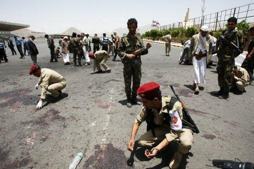 "Yemeni military police collect evidence at the site of a suicide bomb attack in Sanaa on Monday. Yemeni police officer Colonel Abdul Hamid Bajjash, in charge of security at the blast area, said the attack ""bears the hallmark of Al-Qaeda."""