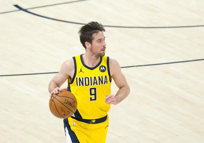 Apr 16, 2021; Salt Lake City, Utah, USA; Indiana Pacers guard T.J. McConnell (9) dribbles up the court during the second half against the Utah Jazz at Vivint Smart Home Arena.