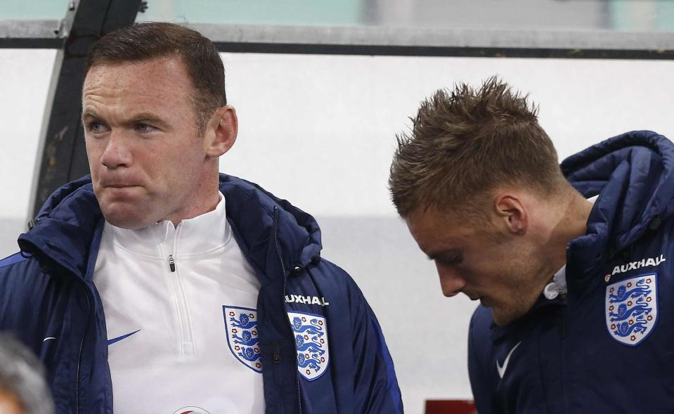 England's Wayne Rooney, left, and Jamie Vardy takes their seats on the bench before the World Cup Group F qualifying soccer match between Slovenia and England, at Stozice stadium in Ljubljana, Slovenia, Tuesday, Oct. 11, 2016. (AP Photo/Darko Bandic)