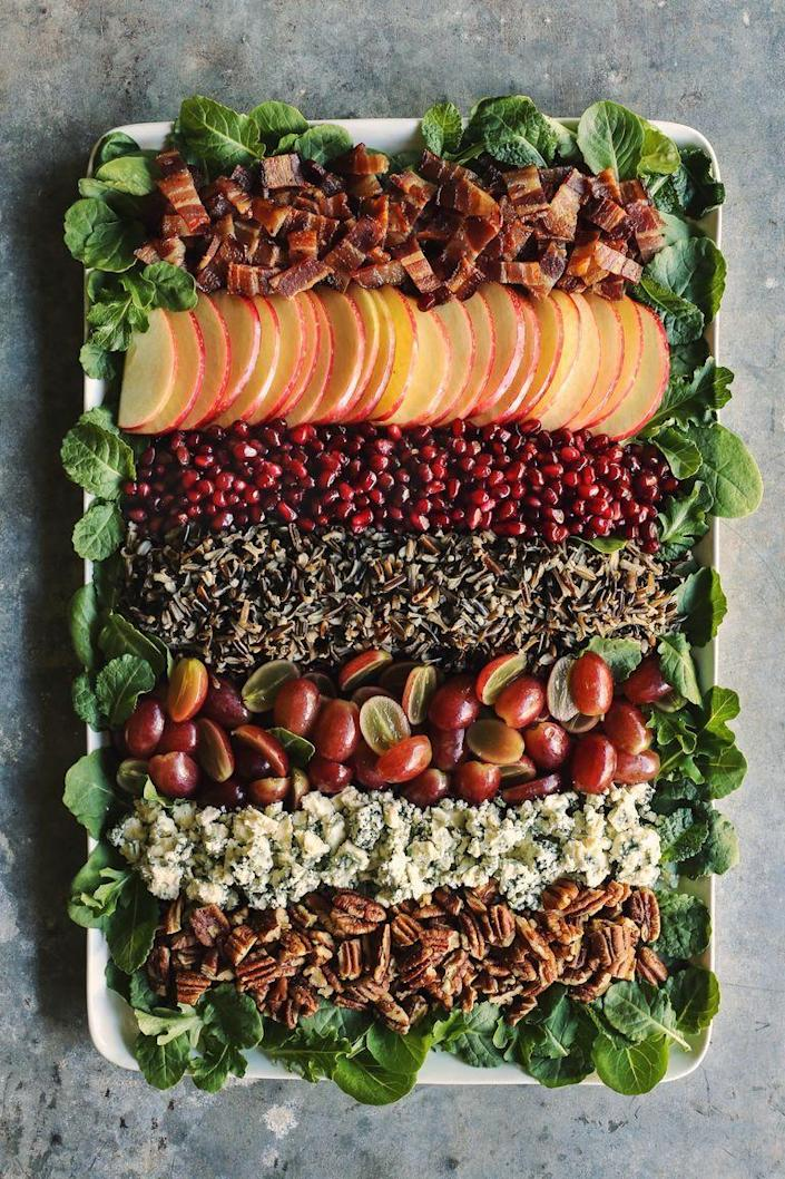 """<p>We love a hearty fall salad with tons of toppings and this one is loaded with crispy bacon, nuts, cheese, and thinly sliced apples. It's perfect for your holiday table! </p><p><a href=""""https://www.thepioneerwoman.com/food-cooking/recipes/a100072/holiday-wild-rice-salad/"""" rel=""""nofollow noopener"""" target=""""_blank"""" data-ylk=""""slk:Get the recipe."""" class=""""link rapid-noclick-resp""""><strong>Get the recipe. </strong></a></p><p><a class=""""link rapid-noclick-resp"""" href=""""https://go.redirectingat.com?id=74968X1596630&url=https%3A%2F%2Fwww.walmart.com%2Fsearch%2F%3Fquery%3Dpioneer%2Bwoman%2Bserving%2Bplatters&sref=https%3A%2F%2Fwww.thepioneerwoman.com%2Ffood-cooking%2Fmeals-menus%2Fg37145681%2Feasy-apple-recipes%2F"""" rel=""""nofollow noopener"""" target=""""_blank"""" data-ylk=""""slk:SHOP SERVING PLATTERS"""">SHOP SERVING PLATTERS</a></p>"""