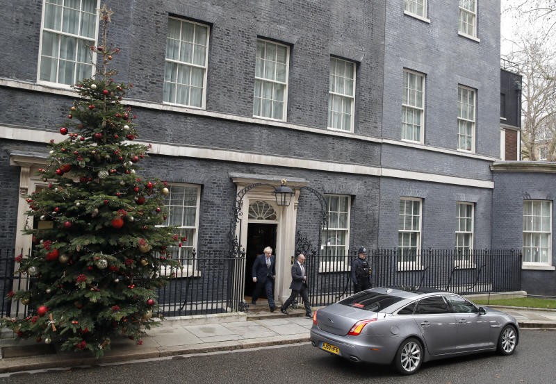 Britain's Prime Minister Boris Johnson leaves number 10 Downing Street in London, Friday, Dec. 13, 2019 on his way to meet Queen Elizabeth II to seek her approval to form a new government. Prime Minister Boris Johnson's Conservative Party has won a solid majority of seats in Britain's Parliament — a decisive outcome to a Brexit-dominated election that should allow Johnson to fulfill his plan to take the U.K. out of the European Union next month. (AP Photo/Thanassis Stavrakis)