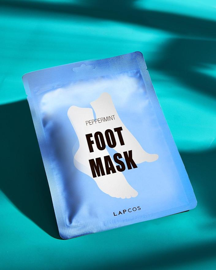 """<h3>LAPCOS Foot Mask<br></h3><br><strong>Karina (Me!)</strong><br><br>""""In quarantine, I've been doing the most when it comes to pampering my feet — and this well-priced foot sheet mask has become my latest obsession. It's similar to <a href=""""https://amzn.to/3f3Bw4c"""" rel=""""nofollow noopener"""" target=""""_blank"""" data-ylk=""""slk:Baby Foot"""" class=""""link rapid-noclick-resp"""">Baby Foot</a> in that one packet contains a single-use pair of plastic booties soaked with serum. But instead of creating a magical-molting effect, this masks hydrates and revitalizes tired toes with the help of peppermint oil and lavender. After removing and rinsing, you're left with nothing but soft and soothed feet that smell like a spa day."""" <br><br><strong>LAPCOS</strong> Foot Mask, (1-Pack), $, available at <a href=""""https://amzn.to/3bdIS4j"""" rel=""""nofollow noopener"""" target=""""_blank"""" data-ylk=""""slk:Amazon"""" class=""""link rapid-noclick-resp"""">Amazon</a>"""