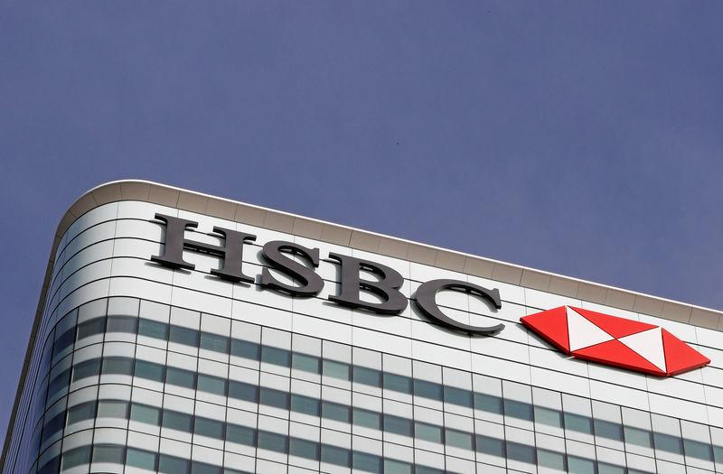 FILE PHOTO: FILE PHOTO - The HSBC bank logo is seen at their offices in the Canary Wharf financial district in London