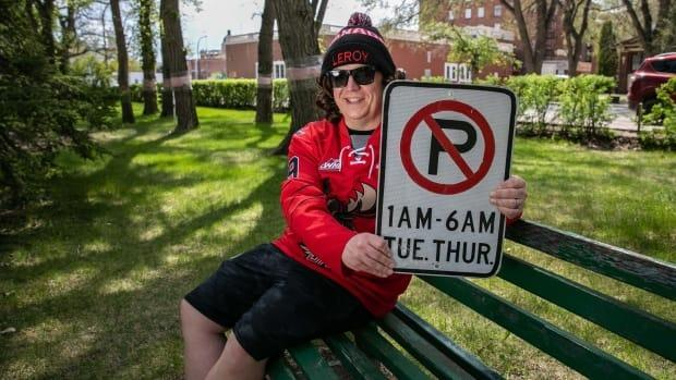 Myers with a sign given to the comedy duo after it was removed by the City of Moose Jaw.