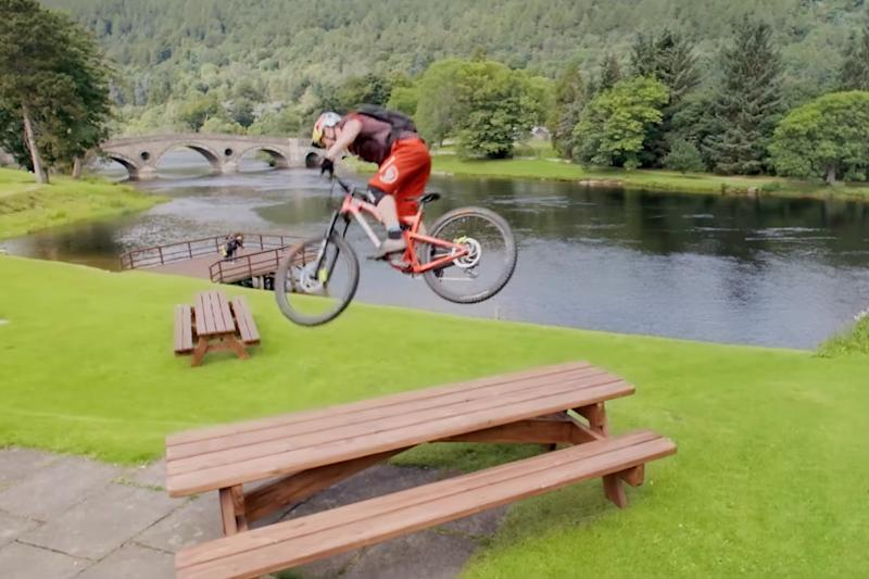 Watch this daredevil cyclist perform epic stunts on a 'wee day out' in Scotland