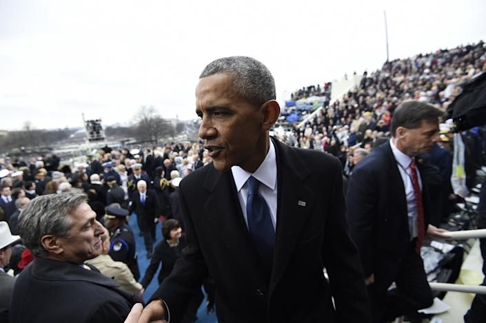<p>Former President Barack Obama shakes hands as he leaves Capitol Hill in Washington, Friday, Jan. 20, 2017, after the Presidential Inauguration of Donald Trump. (Photo: Saul Loeb/Pool Photo via AP) </p>