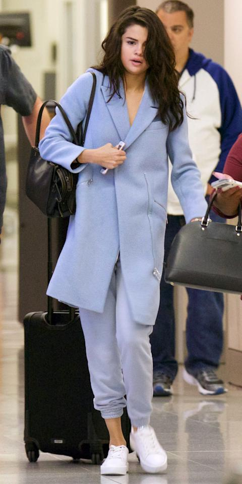 <p>The singer was spotted at the airport in Atlanta wearing head-to-toe periwinkle blue. Her travel look consisted of a cozy wool coat, matching cropped sweatpants, fresh white sneakers, and a black leather bag.</p>